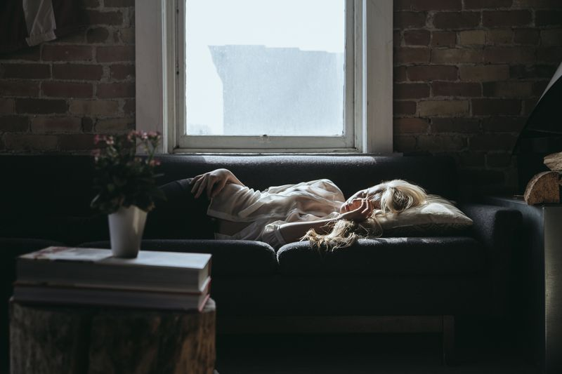 Royaltyfree-sleeping-on-the-couch