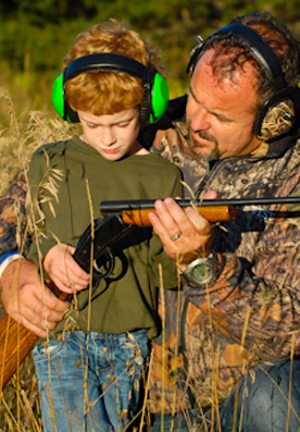 Father and Son in high-quality hearing protection ear muffs