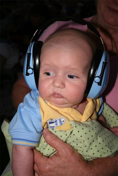 Jackson, 2 months old, wearing powder blue ear muffs for children. Photo courtesy of Kristen.