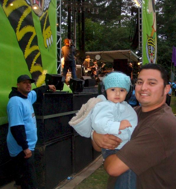 Gianna, 18 months, wearing her kid ear muffs at the Beck concert!