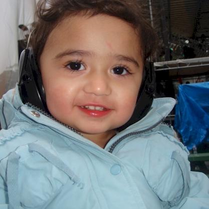 A closeup of Gianna wearing her muffs!