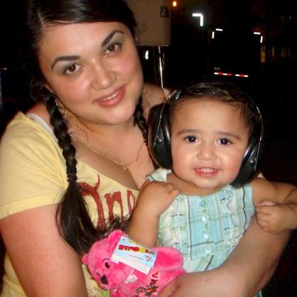 Gianna wears her Ear Muffs for Children everywhere!