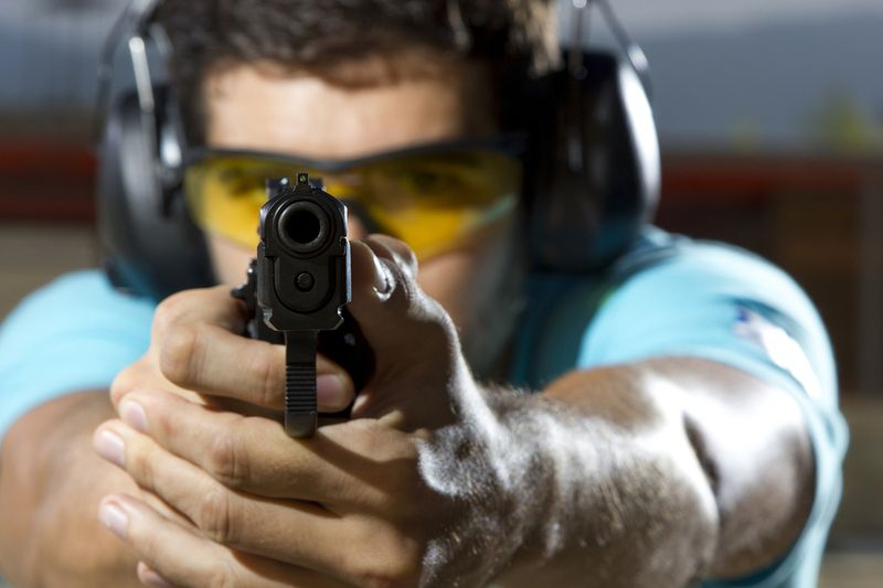 Bigstock-Man-shooting-on-an-outdoor-sho-38938159